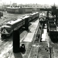 RR116-Looking west Wabash diesel engines 1154A and E-7 1007 roundhouse in the distance at Decatur, Il 07-20-1953   015.jpg