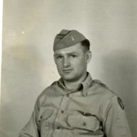Photo of Lt. Robert Adams, in uniform, holding the number 45.