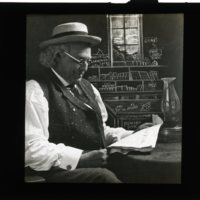 WS1542-man_reading_paper_in_store053.jpg