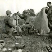 AF211-WWII_FERGUSON, KENNETH, KNEELING RIGHT, 12-19-1944.jpg