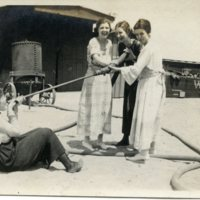 RF201-Ladies_playing_with_hose-Wabash_train_yard234.jpg