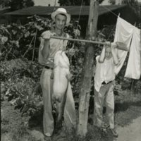 RC92-man and boy holding catfish.jpg