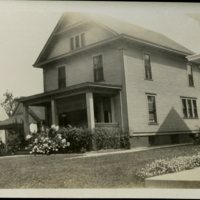 HH32-1927 - House with Man on Porch.jpg